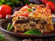 Гръцка мусака от телешка кайма, патладжан, картофи, моркови, сирене, кашкавал и заливка от сос бешамел